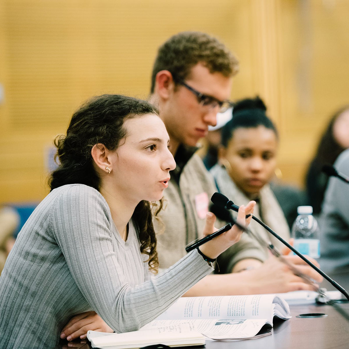 A Hillel student speaks into a microphone at a conference